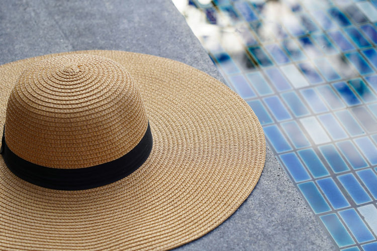 High angle view of hat by swimming pool