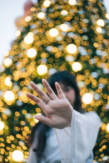 Capture Tomorrow One Person Human Hand Real People Human Body Part Hand Gesturing Lifestyles Focus On Foreground Tree Illuminated Body Part Leisure Activity Human Finger Front View Finger Holiday Christmas Men Celebration Outdoors