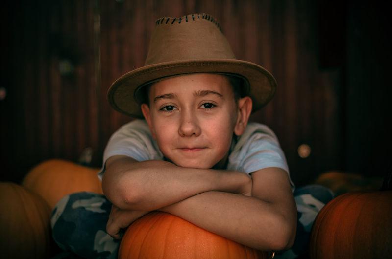 Portrait of cute boy holding pumpkin