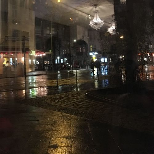 Wet illuminated city during rainy season