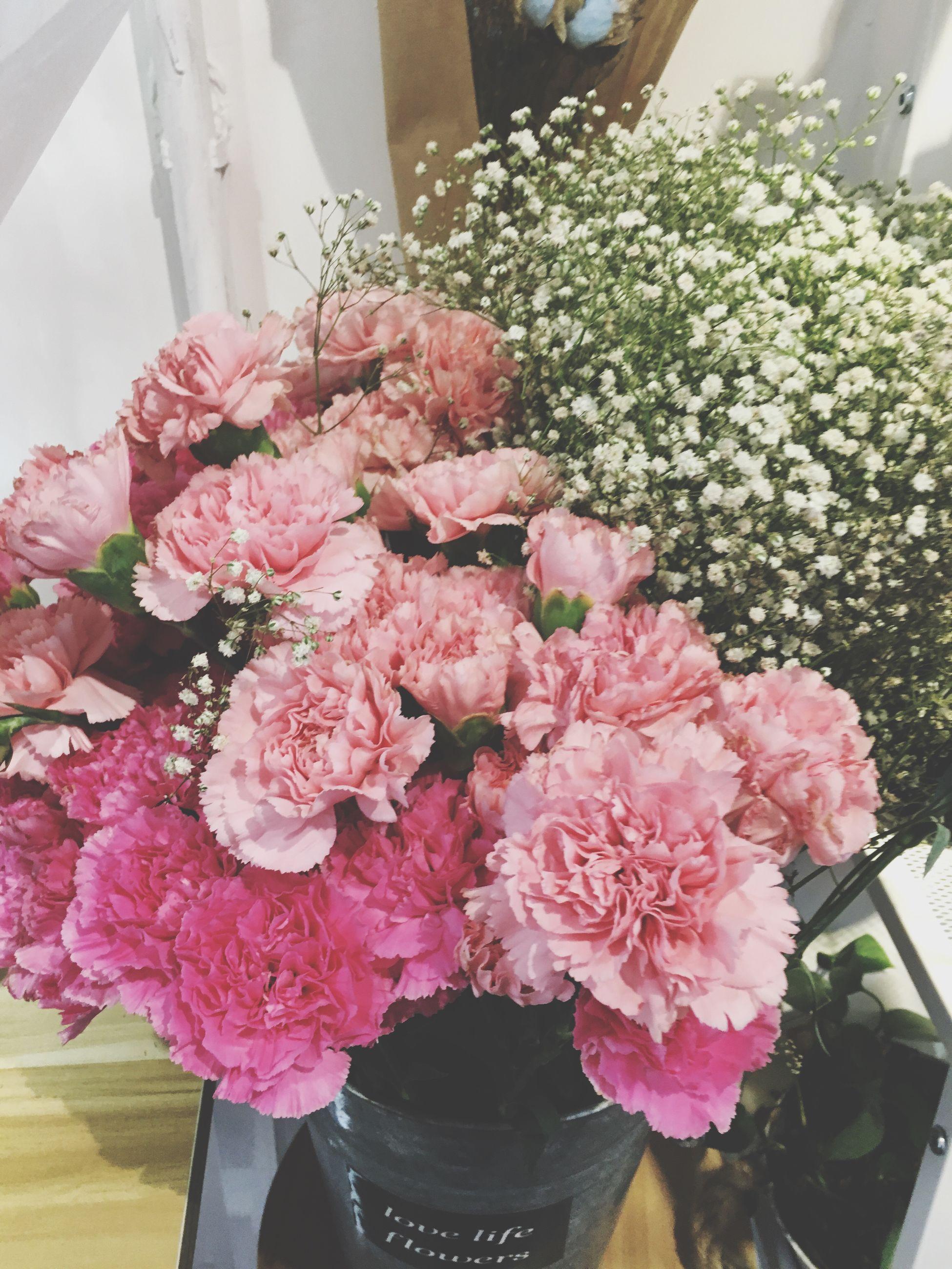 flower, beauty in nature, fragility, bouquet, nature, pink color, freshness, no people, rose - flower, petal, close-up, flower head, plant, indoors, flower shop, growth, day, flower market, florist