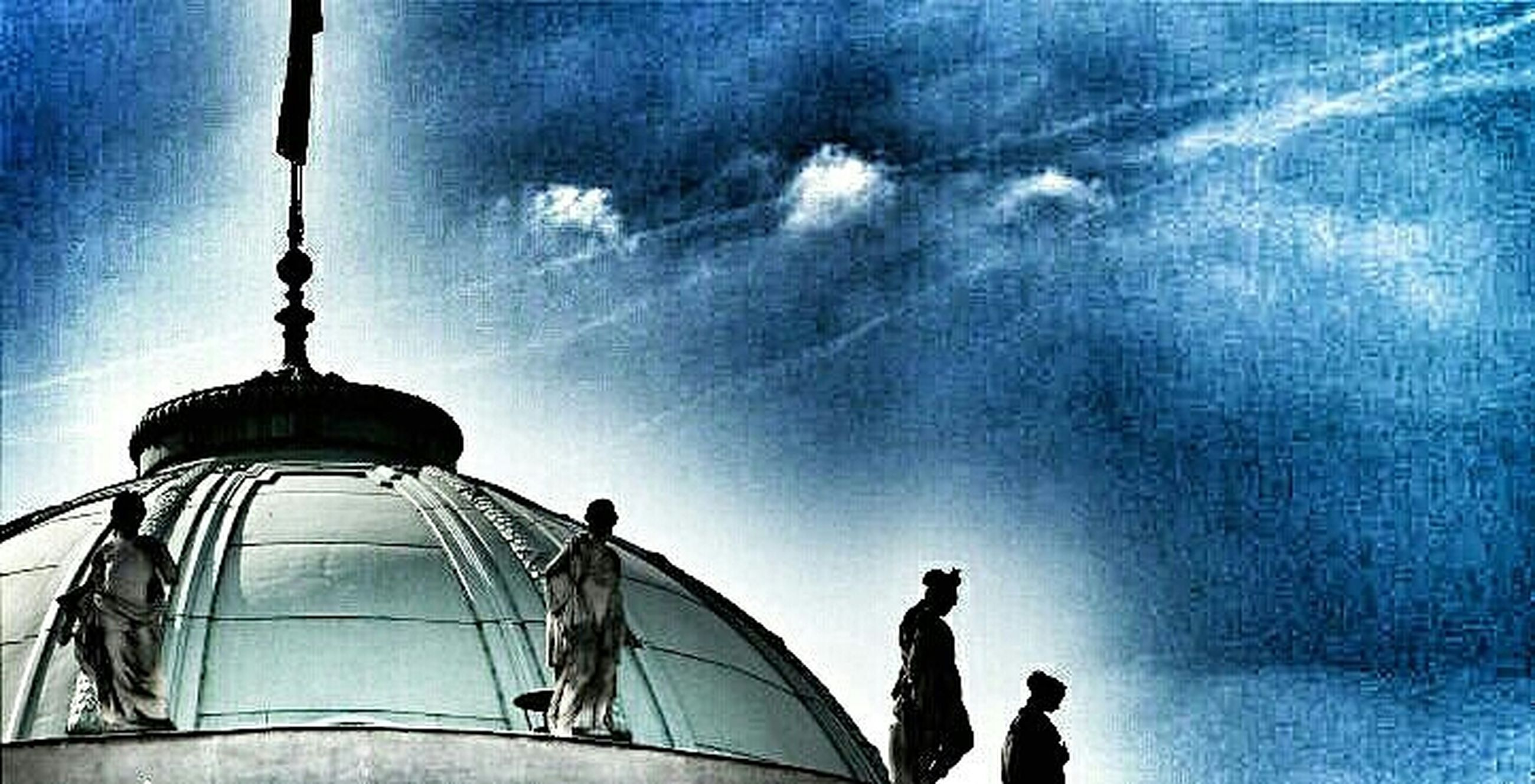 low angle view, sky, built structure, architecture, building exterior, cloud - sky, blue, dome, sculpture, statue, cloud, art and craft, human representation, high section, art, famous place, creativity, cloudy, outdoors, travel destinations