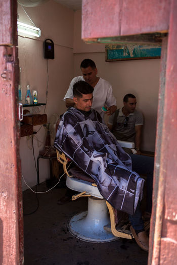 A barber works at his shop in Cienfuegos, Cuba. Barber Barberlife Barbershop Cienfuegos Cienfuegos, Cuba Cuba Cuban Cuban People Frendly Lifestyles Person Portrait Portrait Photography Travel Traveling