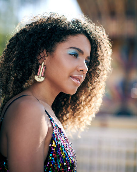 Festival by the Sea, model: Instagram @sandra01martin make-up and styling: Instagram @athenaldn Adult Beautiful Woman Beauty Contemplation Curly Hair Focus On Foreground Hair Hairstyle Headshot Leisure Activity Lifestyles Looking Looking Away One Person Outdoors Portrait Real People Smiling Women Young Adult Young Women Day Dreaming Thinking Pensive Eye Make-up The Fashion Photographer - 2018 EyeEm Awards The Portraitist - 2018 EyeEm Awards