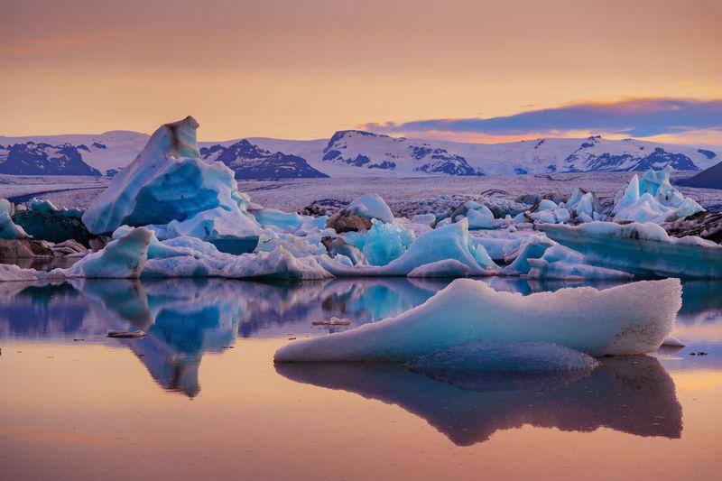 Icebergs And Mountains On Jokulsarlon Glacial Lagoon
