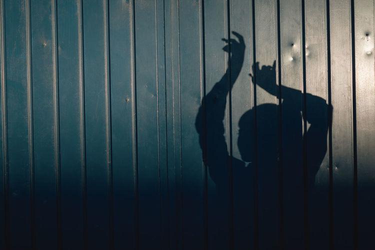 Shadow of man on metal wall