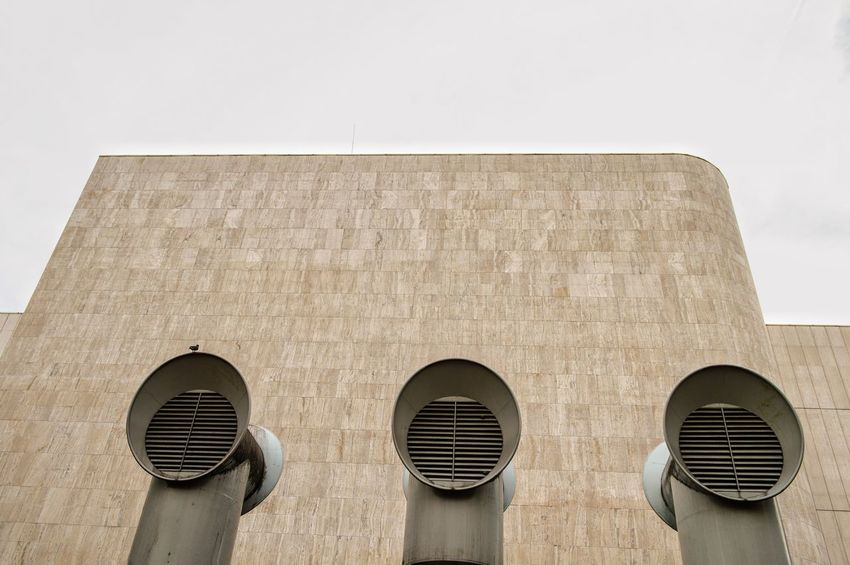 Urban Perspectives Urban Geometry Air Conditioner Air Duct Architectural Detail Architectural Feature Architecture Building Building Exterior Built Structure Copy Space Day Design Geometric Shape Low Angle View No People Outdoors Pattern Shape Sky Urbanphotography Wall - Building Feature The Architect - 2018 EyeEm Awards