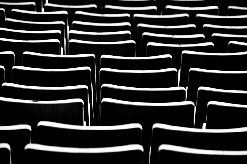 Full frame shot of empty chairs in stadium