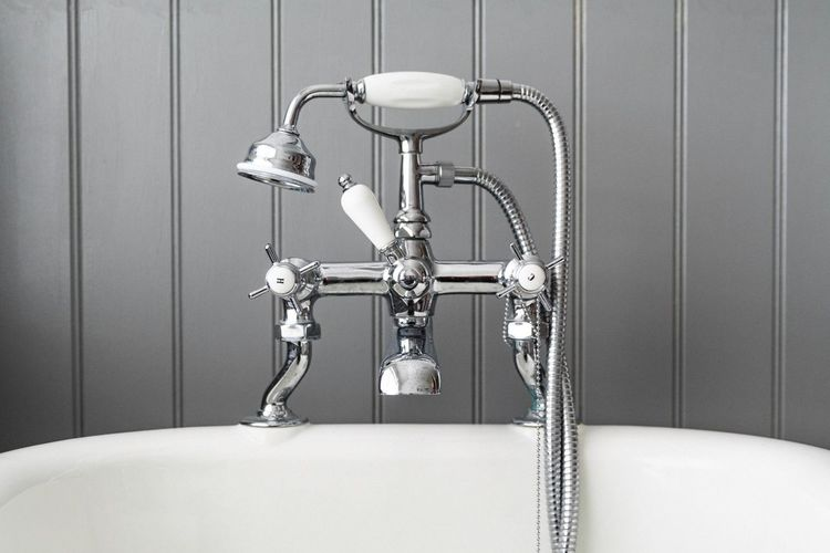 Close-up of shower head in bathtub