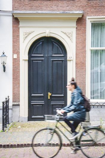 Dutch street Building Exterior Architecture Entrance Door One Person Built Structure Real People Building Day Bicycle Young Adult