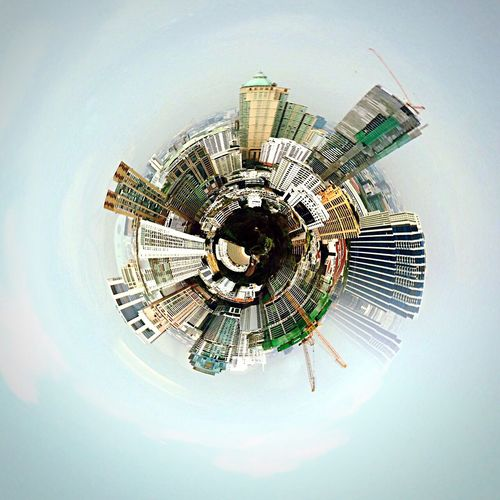 Little planet effect of buildings against sky