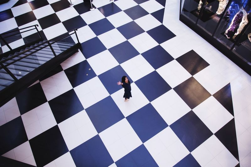High angle view of people standing on tiled floor