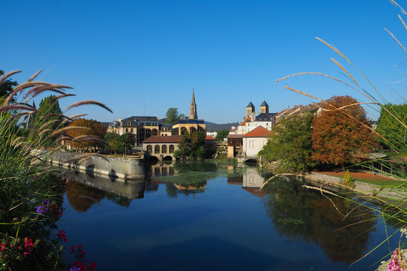 A stunning scenario in Metz French Water Architecture Sky Reflection Built Structure Building Exterior Plant Nature Building Tree Clear Sky No People Blue Lake Waterfront Day Place Of Worship Religion French Metz, France Travel Postcard Backgrounds