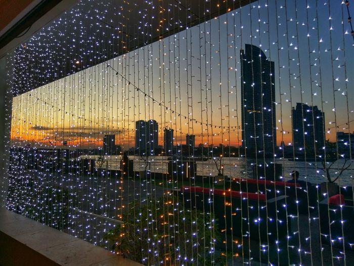 City buildings seen through wet glass window