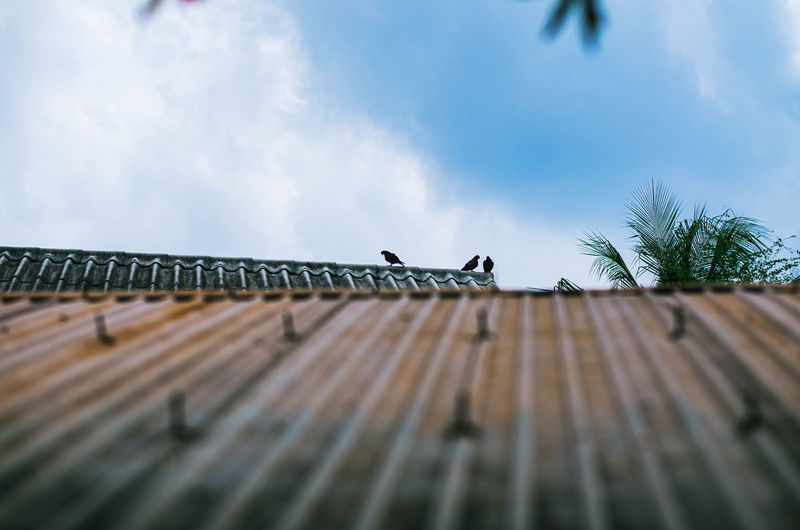 Low angle view of roof against sky