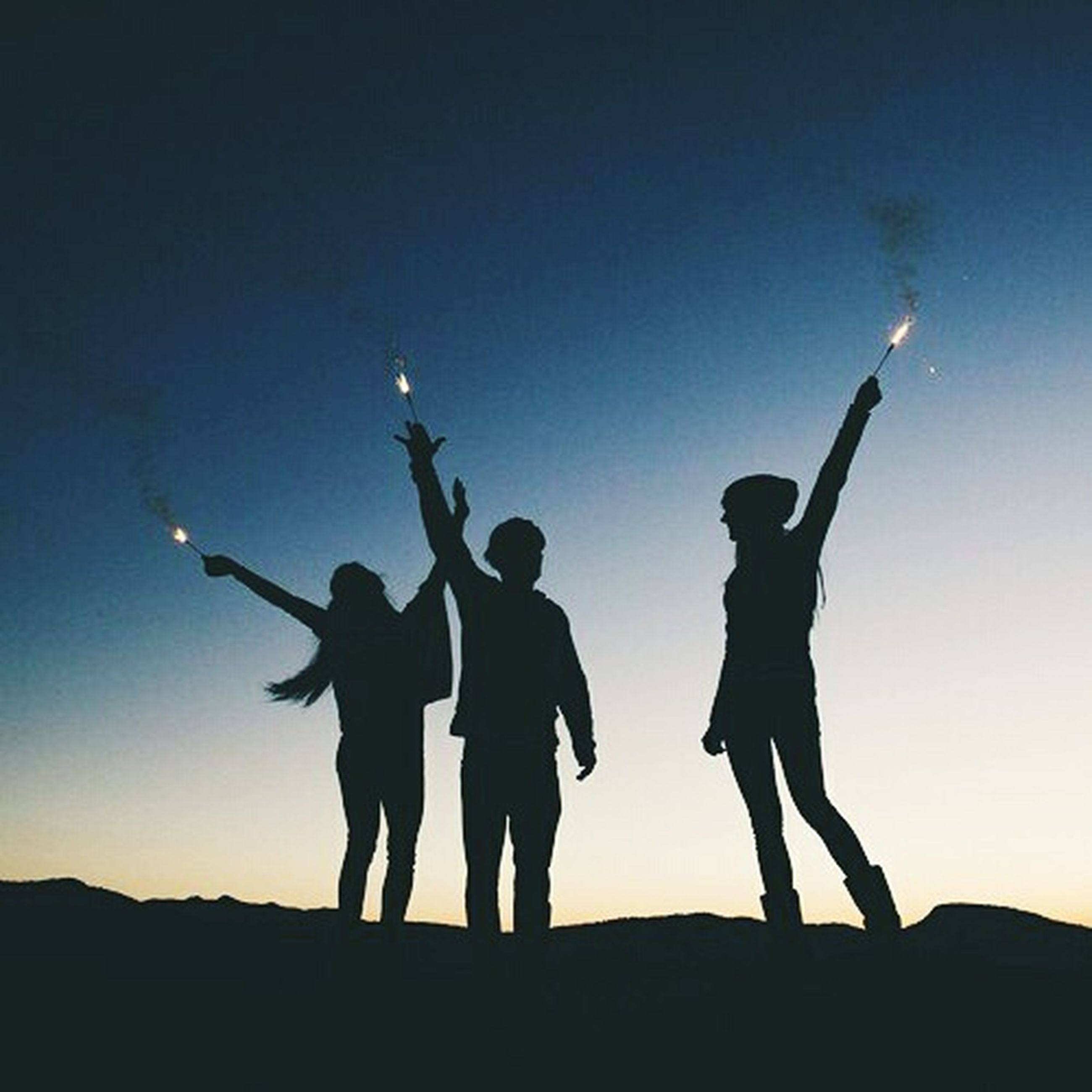 silhouette, men, togetherness, lifestyles, leisure activity, standing, full length, copy space, sky, bonding, clear sky, friendship, sunset, person, low angle view, love, blue