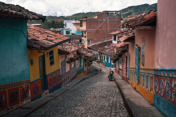The colorful pueblito of Guatapé. South America Latin America Outdoors Day Explore Architecture Built Structure Nature Sky Building Exterior Building House Residential District City Direction The Way Forward Wall Street Footpath Town Cobblestone Wall - Building Feature Walking Alley Colorful Paint Painted Pattern Village Road The Traveler - 2019 EyeEm Awards