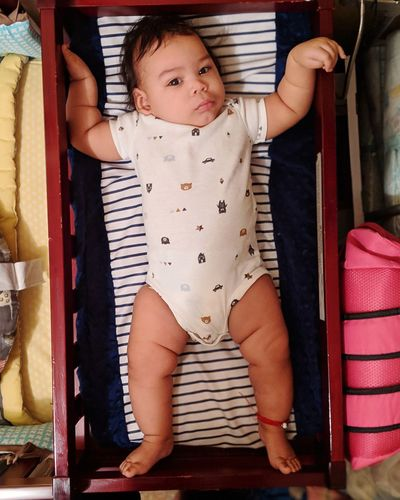 Full length of cute baby at home