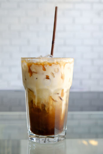 Refreshment Food And Drink Drink Glass Drinking Glass Indoors  Drinking Straw Close-up Household Equipment Straw Food Freshness Coffee Still Life Focus On Foreground Iced Coffee Cold Drink Indulgence No People Coffee - Drink Temptation Caffeine