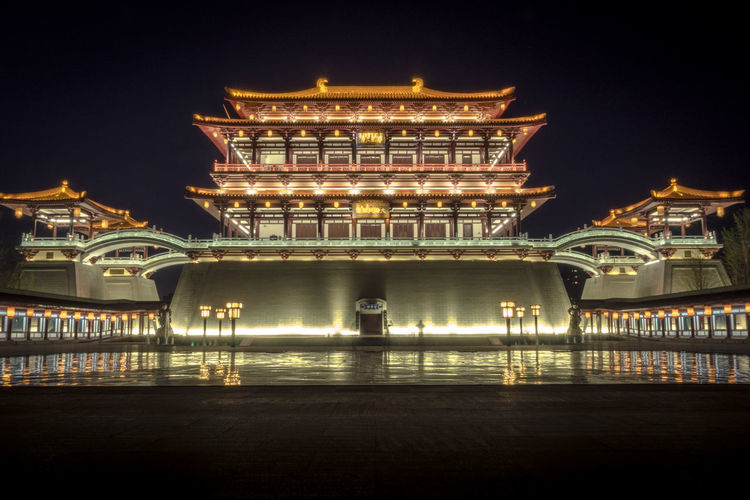 Illuminated traditional building against sky at tang paradise