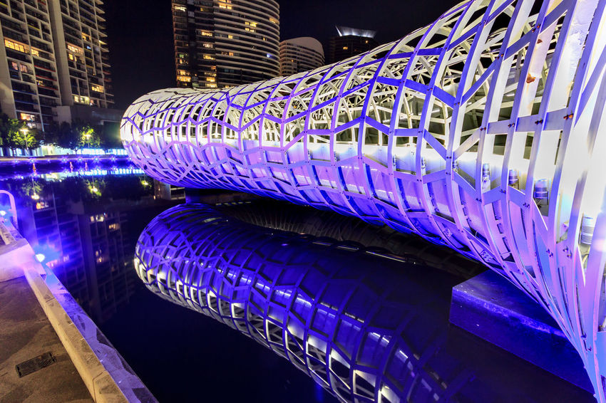 Reflection of the Webb Bridge Reflection Architecture Blue Bridge - Man Made Structure Building Exterior Built Structure City Illuminated Night No People Outdoors
