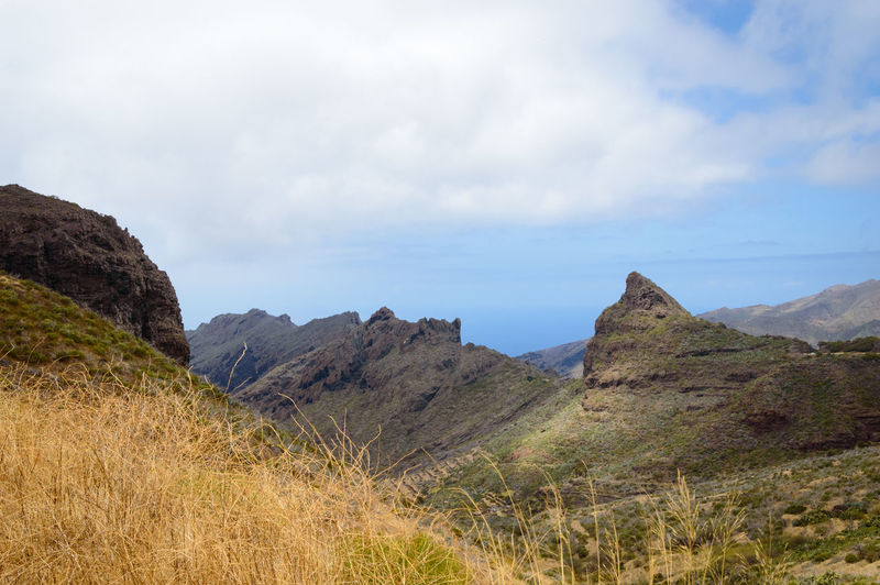 Rocky landscape under a blue cloudy sky on Tenerife island, Spain Grass Lonely Nature Rocky SPAIN Tranquility Travel Adventure Clouds First Eyeem Photo Landscape Mountain Nature_collection Scenics Sky Tenerife