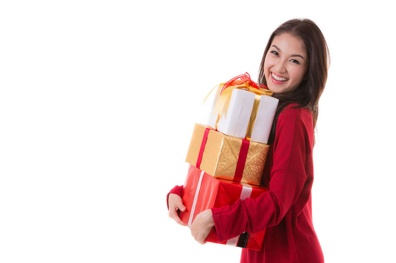 Merry Christmas Adult Adults Only Beautiful Woman Beauty Celebration Cheerful Christmas Christmas Present Females Gift Happiness Holding Looking At Camera One Person One Woman Only One Young Woman Only Only Women People Portrait Smiling Studio Shot Winter Women Young Adult Young Women