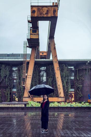 Full length of man standing on wet rainy day