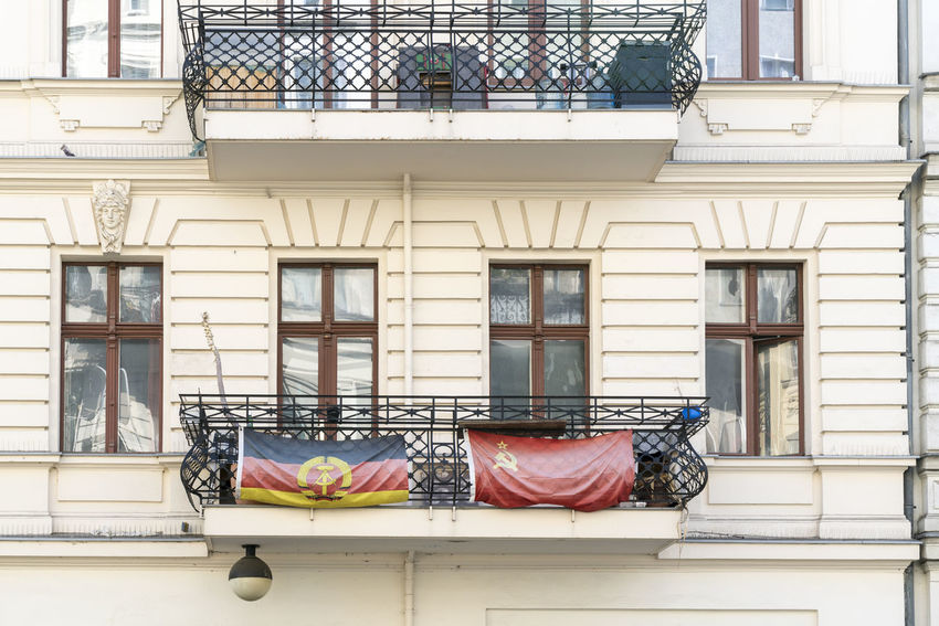 Balcony Berlin Communism Conflict Flag GDR Gentrification History House Kreuzberg Opinion Opposition Past Politics Social Issues Society Symbol USSR,