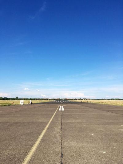 Runway against blue sky