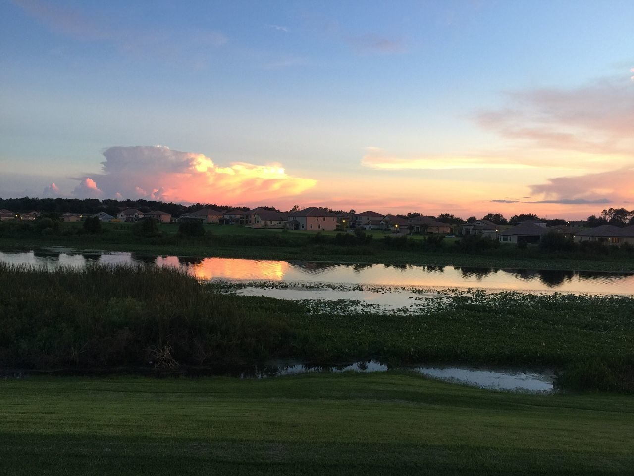 sunset, nature, water, scenics, beauty in nature, sky, tranquil scene, tranquility, lake, reflection, grass, landscape, no people, outdoors, field, cloud - sky, tree, day
