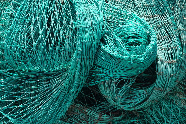 Full frame shot of fishing net at harbor