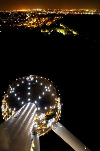 Illuminated Night Futuristic Space Astronomy Galaxy Sky Modernism Atomium Belgium Brussels Sightseeing Nightview Bird View Cityscape Architecture Structure Monument Reflection UFO Planet End Of The World Warm Outdoors Landmark AI Now