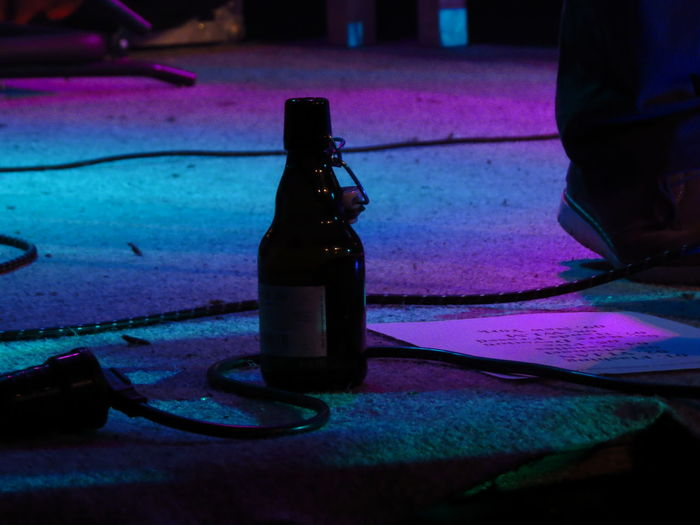Band Band Practice Beer Beer Bottle Beerporn Bottle Bühne Cables Close-up Drinking Beer Flask Illuminated Jar Leisure Activity Lifestyles On Stage Festival Season Performing On Stage Playing Music Rehearsal Selective Focus Stage Stage - Performance Space Stage Lights Stage Show