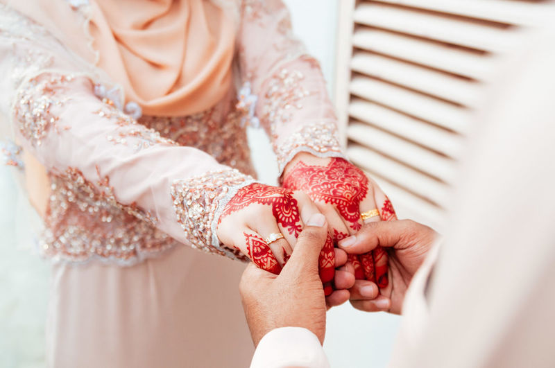 High angle view of couple holding hands during wedding ceremony