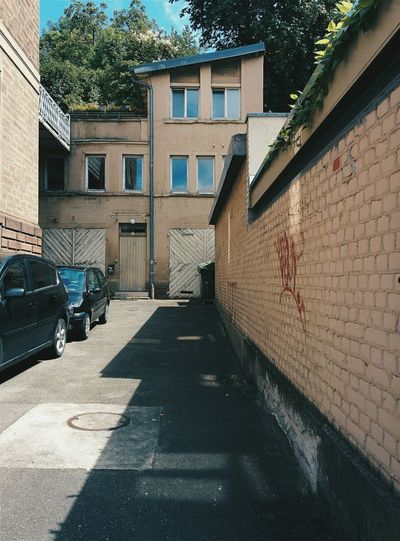 Alley with parking cars