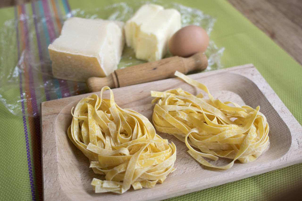 pasta, italian food, food and drink, cutting board, freshness, raw food, preparation, indoors, food, high angle view, healthy eating, spaghetti, no people, close-up, day