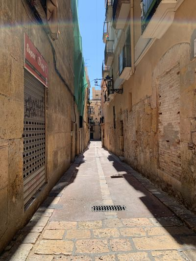 Narrow street between buildings in city