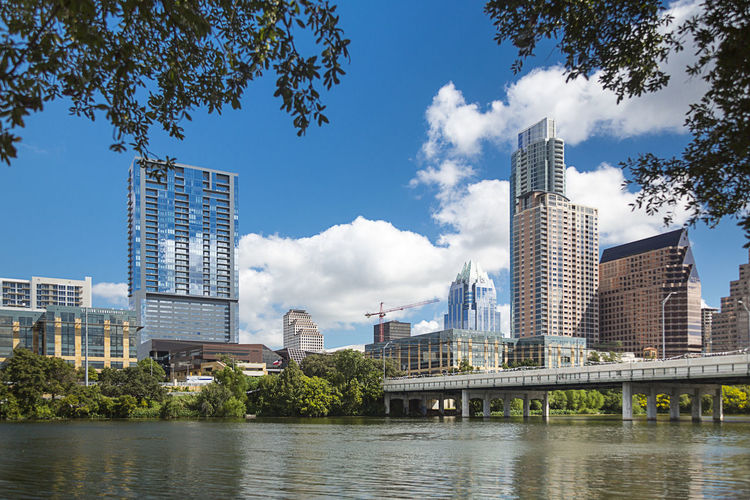The skyline of Austin, Texas Austin Beautiful Branch Bridge Down Frost Building JW Marriott Lady Bird Lake Reflection Relaxing Sky Skyscraper Sunny Texas The Lone Star State Waterfront