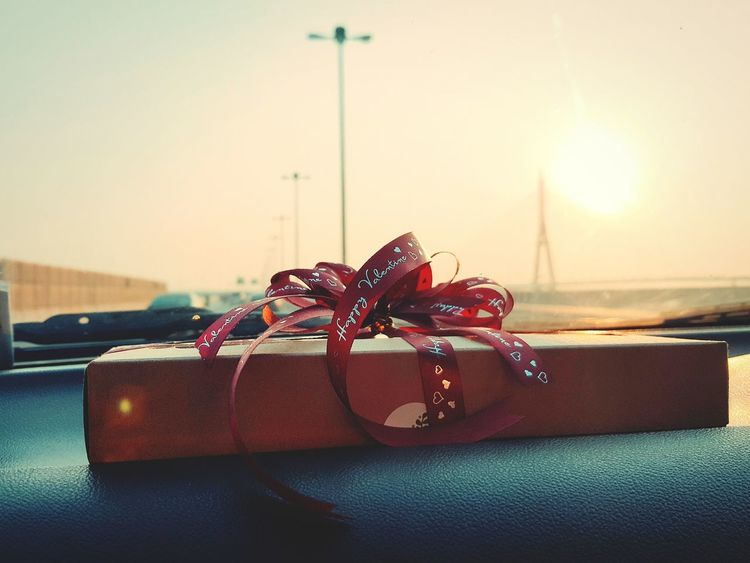 Sky Box Valentine's Day  Dessert In The Morning Valentine's Day  Valentine Gifts ❤ Brownies My Boyfriend Incar Bridge View Onroadphotography Golden Shine Onroads Love Gift No People Celebration Celebration Event Illuminated Close-up Gold Colored Red Ribbon Bow Red Ribbons