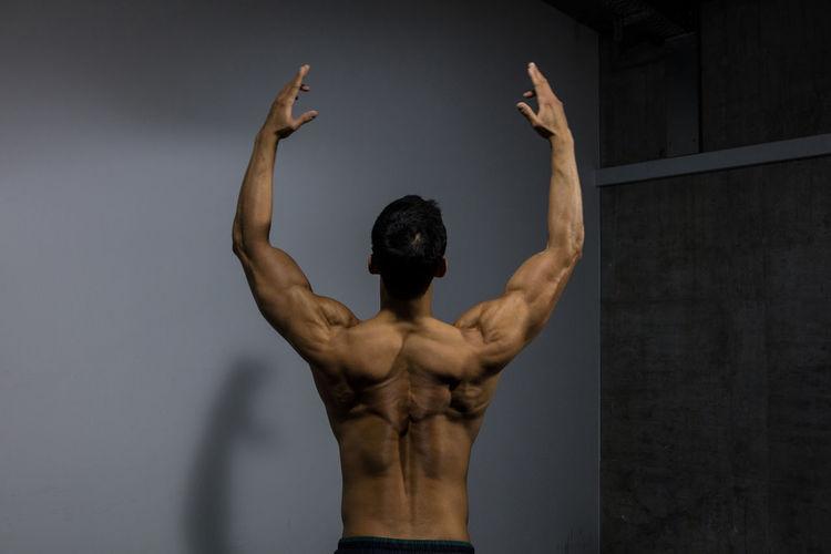 Rear View Of Shirtless Muscular Man