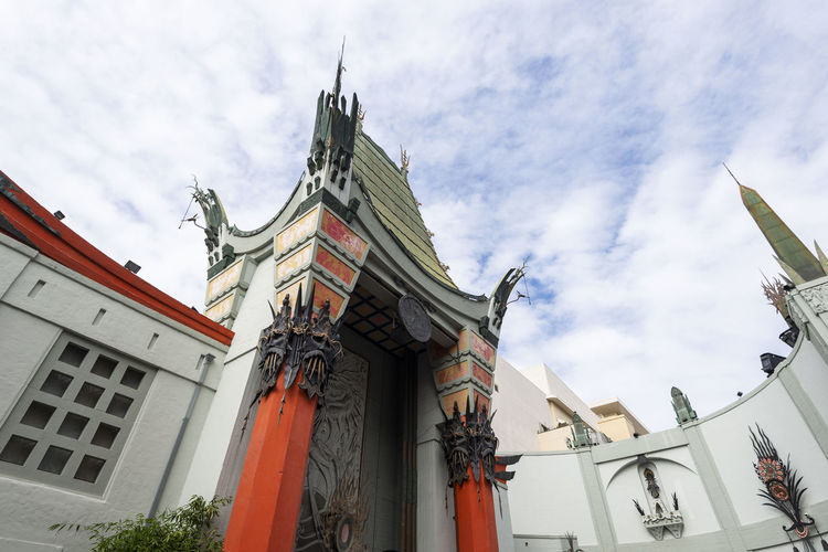 TLC Chinese Theatre front gate, Hollywood Boulevard, LA, USA Art Façade Exterior Industry Corporate Hall Of Fame Entrance Theater Theatre Film MOVIE City Hollywood Entertainment Boulevard Concrete Footprints Landmark Building Sky Travel Architecture Celebrities Hall Chinese Horizontal Cinema Handprints Us Director Fame Tourism Destination United States Tourist Famous Stars Actor Autographs Walk
