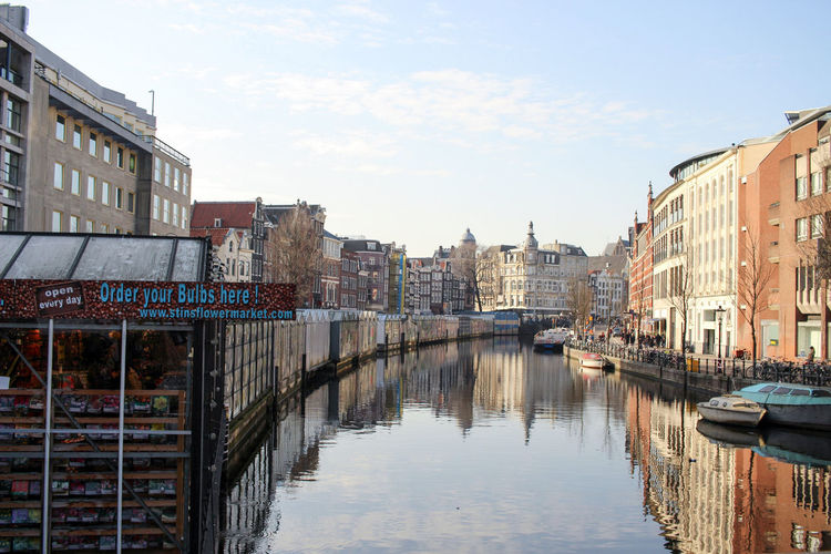 Typical Amsterdam houses at a canal - Flowermarket Amsterdam Architecture City City Life Clear Sky Netherlands Tourist Attraction  Amsterdamcity Architecture Blue Sky Boats Canal Canals And Waterways City Day Daylight Flowermarket No People Tourist Destination Urban Water Waterfront