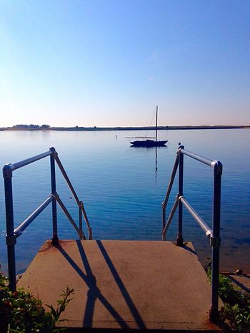 The stillness of the morning. Out for an early morning walk on Cape Cod. Landscapes With WhiteWall Still The Essence Of Summer Early Morning Morning Ocean Sailboat Cape Cod New England  Massachusetts Water Shadow Silhouette Stairs Beautiful Capture South Yarmouth Vacation Time Vacation Happiness Freedom Capture The Moment Summer Clear Reflection Sommergefühle