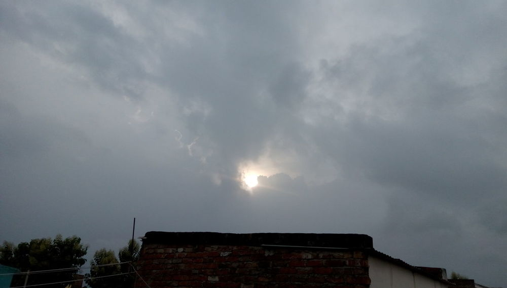 Sun behind clouds Sunbeam Mansoon Almost Here Nature