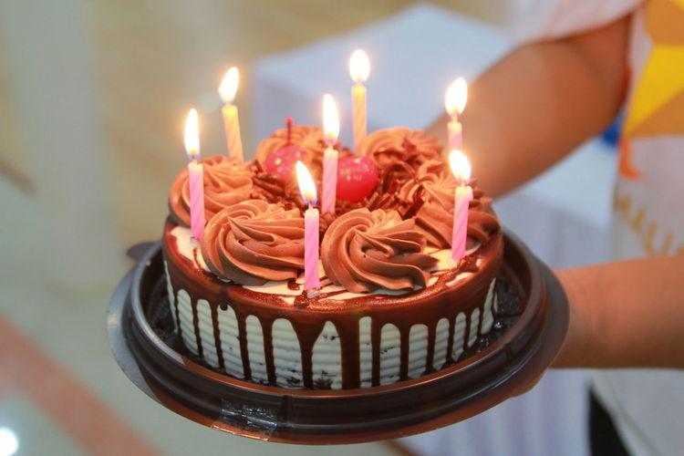 Human Hand Birthday Cake Birthday Flame Party - Social Event Birthday Candles Celebration Heat - Temperature Dessert Burning Diya - Oil Lamp Tea Light Cigarette Lighter Darkroom Candle Matchstick Diwali Match - Lighting Equipment Bonfire Wax Glowing Fire - Natural Phenomenon Oil Lamp Candlelight Lit Igniting