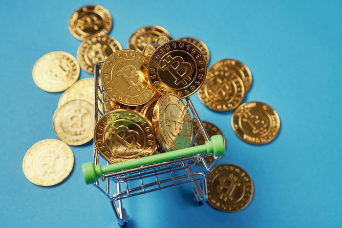 Gold Bitcoin placed in a small shopping cart. Digital currency concepts can be used to make online purchases. Business Economy Growth Rate Accounting Bitcoin Capital Cash Coin Cost Currency Deposit Finance Gold Colored Income Inflation  Insurance Investment Metal Money Piggy Profit Retirement Savings Wealth