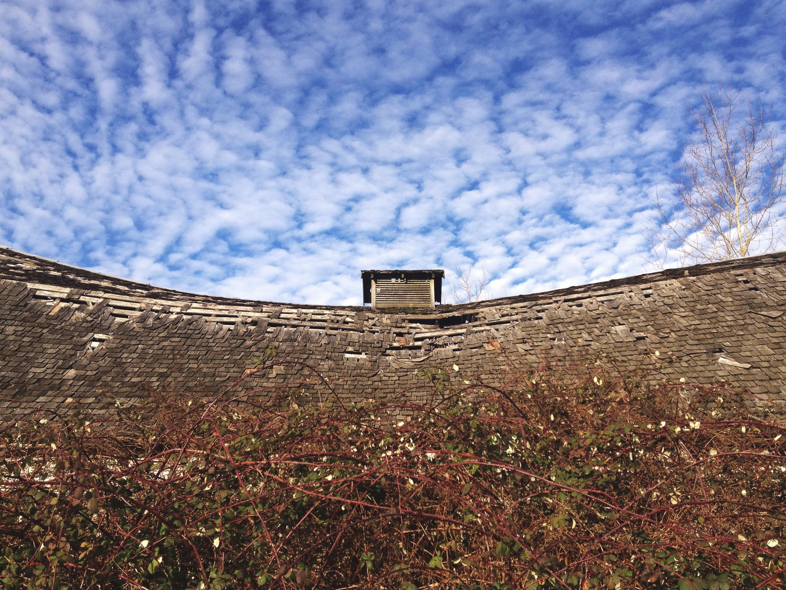 architecture, built structure, building exterior, sky, cloud - sky, low angle view, cloud, cloudy, house, day, old, wall - building feature, outdoors, no people, stone wall, blue, building, abandoned, history, nature