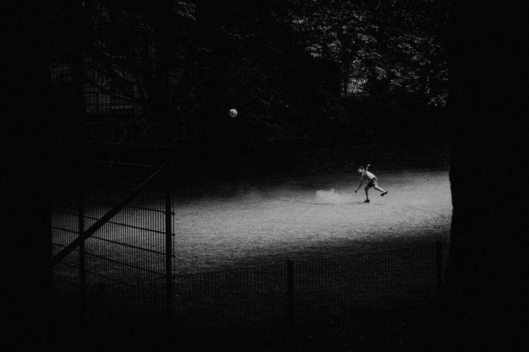 Silhouette people walking on street at night