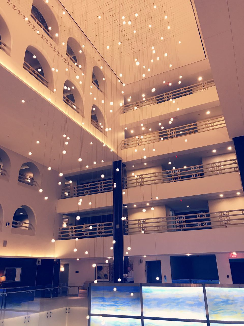 modern, architecture, illuminated, indoors, staircase, ceiling, lighting equipment, built structure, no people, steps, luxury, business, low angle view, luxury hotel, home showcase interior, day